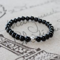 Sale, use shop coupon code) Black Onyx Beaded Stretch Bracelet, Black Onyx and Sterling Silver. on Etsy, $18.00 CAD