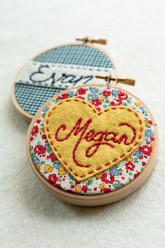 use fabric bits leftover from quilts to make matching name hoops - one hoop for each letter maybe, either embroidered or appliqued.