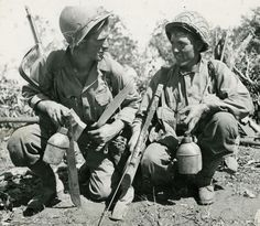Pvt William and Pvt Seber Cough,WWII soldiers, pause 80 miles north of Laisho on a grueling 50 mile march.  Photographer Unknown