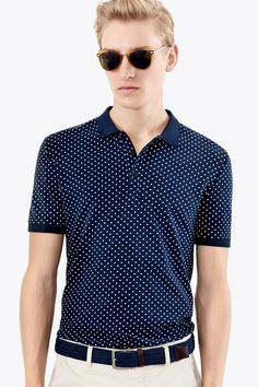 For a sporty shirt that's easy to dress up or down, look no further than this dotted navy blue polo shirt. | H&M For Men