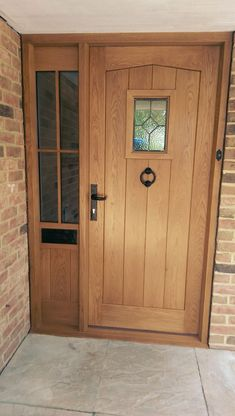 Oak front door and frame with half glazed sidelight - wonder if I could build something similar where w have the door and side window. Hardwood Front Doors, House Design, Interior Barn Doors, Cottage Door, External Doors, Cottage Front Doors, Oak Front Door, Garage Door Design, Front Door Steps