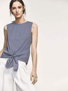 STRIPED TOP WITH KNOT DETAIL voor WOMEN - Shirts & Blouses - View all van Massimo Dutti voor de herfst winter 2017 à 39.95. Natuurlijke elegantie!