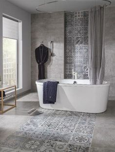 Tiles are a staple of bathroom decoration, and the possibilities for how to utilize them are endless. This year is seeing loads of different tile trends appear Luxury Tile, Bathroom Inspiration, Bathroom Decor, Interior, Tile Bathroom, Black Floor Tiles, Wall And Floor Tiles, Bath Tiles, Bathroom Design