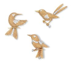 A SET OF DIAMOND AND GOLD BROOCHES, BY CARTIER
