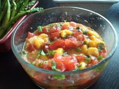 2 cups diced Roma tomatoes 1 1/2 cups diced mango 1/2 cup diced onion 1 teaspoon white sugar 1/2 cup chopped fresh cilantro 2 tablespoons fresh lime juice 1 tablespoon cider vinegar 1/2 teaspoon salt 1/2 teaspoon black pepper 2 cloves garlic, minced Just add these ingredients together and Enjoy  Recipe from Maria Kang