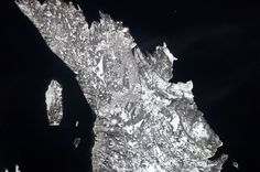 St John's, Newfoundland, on a crystal-clear winter's day. Cape Spear stands out, even from space.