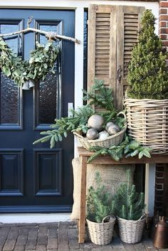 35 amazing winter front porch decor ideas to inspire your holiday decor 2019 - A Nest With A Yard : wicker planter for the trees, combined with wicker baskets full of decorations Small Christmas Trees, Christmas Porch, Noel Christmas, Outdoor Christmas Decorations, Rustic Christmas, Winter Christmas, Winter Decorations, Christmas Style, Christmas Tables