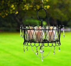 Hanging Basket, Crystals and candles to create a beautiful chandelier. Can also use faux candles or solar lights.