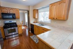 THIS IS ONE THAT YOU CAN MOVE RIGHT INTO AND ENJOY. FENCED YARD - DECK & PATIO PLUS FRESHLY PAINTED - INCLUDES UPDATED KITCHEN & BATHS WITH GREAT LIVING SPACE FOR EVERYONE. CROWN MOULDING IN DINING ROOM - FIRST FLOOR LAUNDRY - FULL BATHROOM IN BASEMENT PLUS REC ROOM AND 5th BEDROOM -...