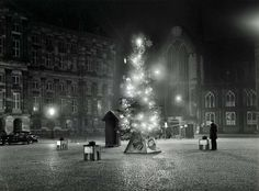 """Christmas on """"De Dam"""" in front of the Royal Palace in Amsterdam. Early 1960's."""