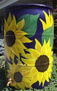 Rain Barrels provide a useful way to save water and money.  They can also add beauty to your yard.  Professional artists can decorate your rain barrels any way you like.  Or simply leave the barrel…