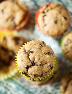 Banana Peanut Butter Chocolate Chip Muffins are the perfect way to use up extra bananas! Recipe on tablefortwoblog.com