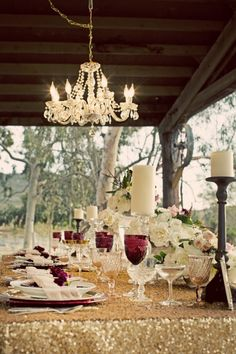 sparkly gold table top with a chandelier  http://www.weddingchicks.com/2014/01/24/rustic-winter-wedding-at-rawhide-ranch-by-christie-rose-events/