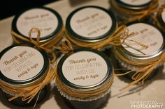 The skirts were white cupcake holders and a special thank-you note was designed for the top. It was all tied off with raffia, of course. Cupcake Holders, Candle Jars, Candles, White Cupcakes, Jelly Jars, Party Favors, Shower Ideas, Raspberry, Parties