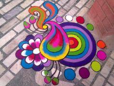These New Year rangoli designs may not be as detailed as Sankranti rangoli designs or Diwali rangoli or even the themed ones like Ganesh rangoli, and so on. Rangoli Designs Peacock, Colorful Rangoli Designs, Rangoli Designs Diwali, Diwali Rangoli, Kolam Designs, Mehandi Designs, Rangoli Colours, Rangoli Patterns, Rangoli Ideas