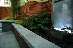 Love this deck, everything works: water feature, beautiful plants  great fence