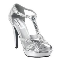 "Made in silver glitter material, this style t-strap platform sandal will match with almost any outfit. An adjustable buckle secures the ankle-strap allowing for stability when wearing this 4"" heel. Great to wear for any special occasion."