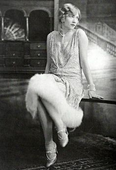 Lame, fur & pearl evening elegance. 1920's.
