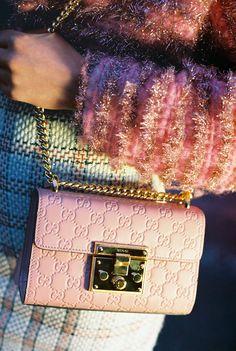 Madeleine Jones, 25, in her own jacket, Gucci tweed dress and Signature Padlock bag.