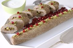 This kibbeh roll, made like a jelly roll cake, is a creation of Aleppo cooks. It is a lot easier and faster to make than kibbeh balls. Two pounds of kibbeh paste will yield three long rolls, of whi...