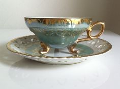RARE Vintage Tea Cup Royal Sealy China Japan Footed Turquoise w/ Gold Trim. $52.95, via Etsy.