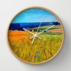 Fields of summer with flowers and scenery Wall Clock