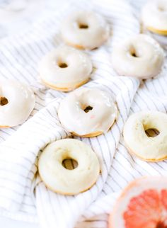 Lemon donuts with grapefruit glaze: http://www.stylemepretty.com/living/2015/08/23/baked-lemon-donuts-with-grapefruit-glaze/ | Photography: Lauren Kelp - http://www.laurenkelp.com/
