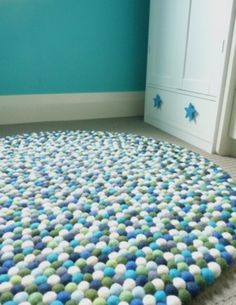 Felt ball rug by Happy As Larry (made of fair-trade felt from Nepal). I can't decide which colour scheme I like best.