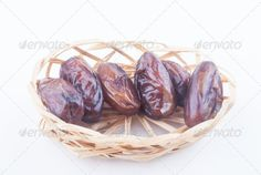 dried fruit ...  arabic, background, bowl, brown, close, color, covered, culture, dactylifera, date, dates, deglet, delicious, dessert, dried, dry, eat, fasting, food, fruit, fruits, heap, iftar, islamic, isolated, macro, many, muslim, natural, nobody, noor, nutrition, organic, palm, phoenix, photo, plenty, portion, ramadan, raw, set, snack, sugar, sweet, tradition, traditional, tropical, up, white