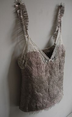 Erwina Ziomkowska ~ Untitled, undershirt with about 5kg of pins hammered into it.