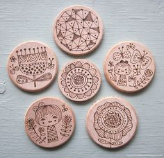 use sharpies to draw doodles on rocks, marbles, etc. and use as reinforcement rewards