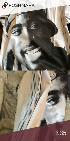 Tupac Shakur Sweatshirt New never worn. It's XL but fits as a medium. It's too small for me. Sweaters Crew & Scoop Necks