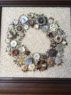 Handsewn framed picture of a wreath using brown & cream buttons with embroidered leaves and stems. It takes me over 100 hours to hand sew all