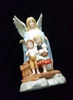 Home interiors guardian angel figurine