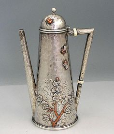 Whiting Mixed Metals Coffee Pot. An antique silver Whiting hand hammered coffee pot with four applied copper and silver insects and applied copper and silver cherry blossom. All applications have additional background hand engraving. Excellent condition. The ivory insulators are tight. The domed shaped lid hinges back to open and closes tightly. Monogrammed on the underside with a script monogram. Circa 1880.