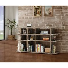 Add a touch of rustic charm to your home with this chic bookcase. The bookcase features nine compartments of various shapes and sizes and a spacious top shelf surface. The salvage cabin wood finish adds old fashioned appeal to this modern design.