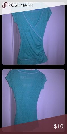 Turquoise V Neck Very steep V neck blouse from Vanity. It's a size medium and is like new! The material is a little see through but not by much at all. Very minimal.  No flaws Vanity Tops