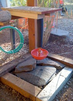 Decorative flagstones added to base of automatic waterer in chicken coop