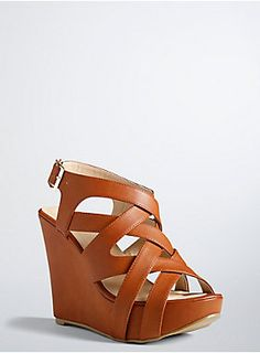 """<p>We have lift off! These stacked platform wedges are elevating (literally) your look to new heights. A crisscrossing strappy front is made versatile with go-with-anything cognac faux leather. Adjustable ankle strap.</p>  <ul> <li>5"""" wedge with 0.75"""" platform</li> <li>Man-made materials</li> <li>Imported</li> </ul>"""