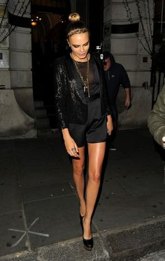 Cara Delevingne all dressed up in a satin play suit and sparkly blazer. #London