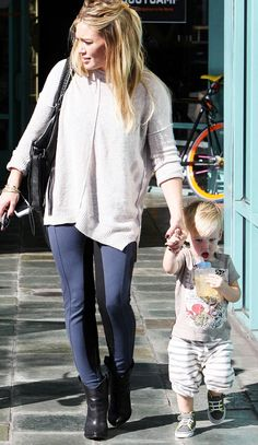 """Hilary Duff 5'2"""" WHAT NOT TO WEAR when you are short. Long baggy sweater. Keep the shirts at the hip bone! Also booties are not for super short women. She should wear a heal and hide it with longer pants. This would give the illusion of more height."""