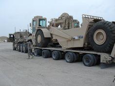 My HET #335 beast from the east hauling a huge earth scraper in Kuwait.