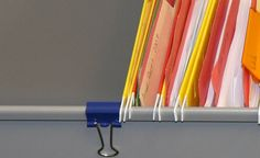 Attach a basic binder clip to file cabinet drawers folder rails. The folders are no longer victim to the forces of momentum, and files stay within quick reach.