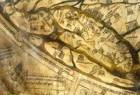 Hereford Mappa Mundi detail. The British Isles are shown on their side, with Scotland on the left and the South of England on the right.  Many cathedral cities can be identified as well as Snowdon and the castles of Carnarvon and Conway in Wales.  Hereford is shown as a small town.