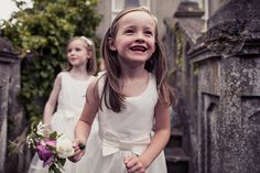 A photojournalistic photograph of two flower girls playing at an outdoor vintage inspired wedding in Boston, Massachusetts Gina Brocker Photography Boston Massachusetts, Flower Girls, Documentaries, Vintage Inspired, White Dress, Wedding Photography, Outdoor, Inspiration, Beautiful