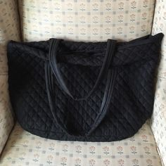 Unstructured quilted handbag Super cute unstructured quilted handbag in black microfiber. Machine wash. Small feet on bottom as pictured. Zip top. One small zip compartment inside. Fits lots of stuff. Great condition. Nila Anthony Bags Shoulder Bags