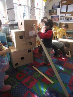 Cardboard boxes with holes cut for cardboard tubes and the wooden ramps.