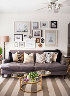 This living room is our sunshine when couches are gray! Gold accents, blush touches, & printed pillows lend an unexpected splash of fun underneath the gorg gallery wall!
