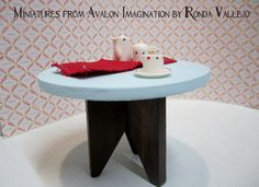 Miniature dollhouse round table in aqua with modern style base 1:12th scale.  via Etsy.