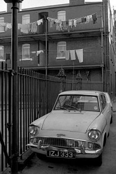 An old Anglia and some washing in Dublin. Photo by Joe Farrell Old Pictures, Old Photos, Vintage Photos, Dublin Street, Photographs And Memories, Old Town, 1960s, Irish, Ireland